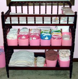 Use dollar store bins to organize the nursery. Repin for later!