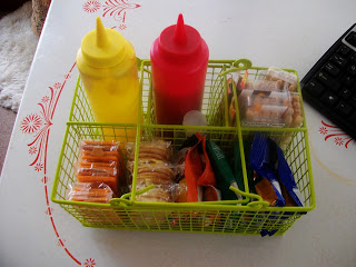 Organize snacks using a dollar store basket for road trips.