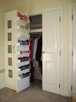 Use a door shelf organizer to store bras inside of your closet door. Repin!