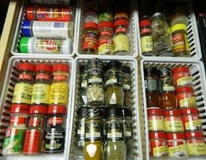 Organize your spices in dollar store bins placed inside of your kitchen drawers. Repin!