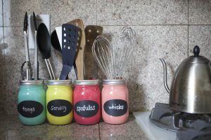 Use mason jars to organize your kitchen counter.