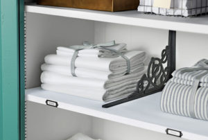 Divide your linen closet shelves using brackets to keep everything organized.