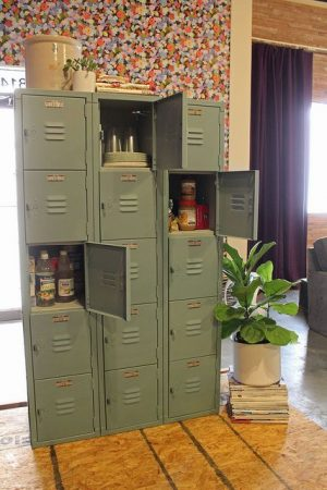 Use a set of old lockers to make a stand alone pantry in a small kitchen .