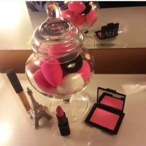 Use a small vanity or cookie jar to store makeup sponges.