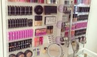 Use clear acrylic shelving to store and organize your makeup on your bathroom wall.