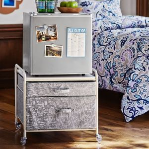 Place your mini fridge on top of a mobile cart for additional storage. Love this idea for a dorm room. Repin!