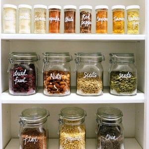 Use canisters to store your spices and handwrite the names on them. Repin if you want to try this idea!