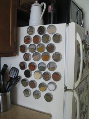 Organize spices on your refrigerator using magnetic containers. Repin if you love this idea!