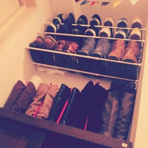 use tension bars to hang your shoes in your closet