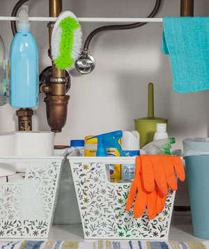 Use tension rods underneath your bathroom sink to store items.