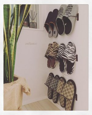 Use a towel rack to store your shoes in an unused corner of your room.