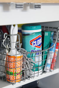 Use wire baskets to store and organize your household cleaning supplies underneath your sink. Repin if you think this brilliant!