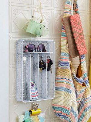 Turn a kitchen utensil organizer into a storage space for your keys and other small items. I want to try this in my dorm room.