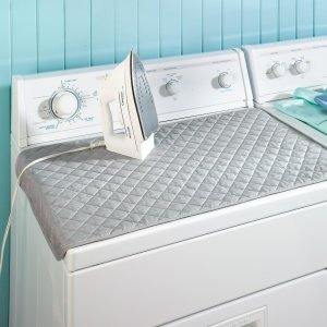 If you don't have room for an iron board in your laundry room, use a portable iron mat instead.