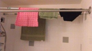 Hang tension rods in your shower to hang wet clothes. No dryer or iron required.