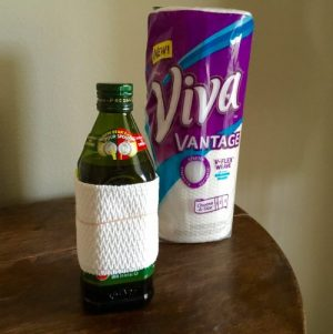 Wrap a paper towel around your oil containers to keep them free from grease and drips.