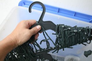 Use a coat hanger to wrap your Christmas lights to keep them from getting tangled while in storage.