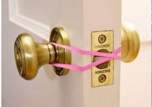Prevent your kids from locking themselves in unattended rooms by looping a rubber band over eaver door handle.