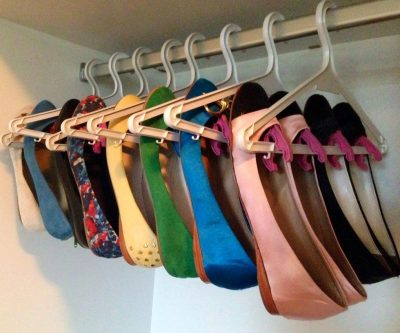 Attach clothespins to your hangers to store and organize your flats in your closet.