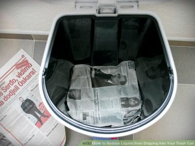 Prevent leaks in your trash can by lining the bag with old newspaper.