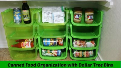 Use stackable dollar store bins to organize canned goods in your kitchen cabinets.