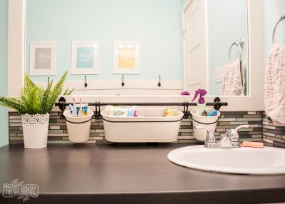 Install a pail rail above your bathroom sink to clear counter clutter and make your bathroom more organized.