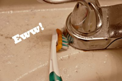 Clean around faucets with a toothbrush.