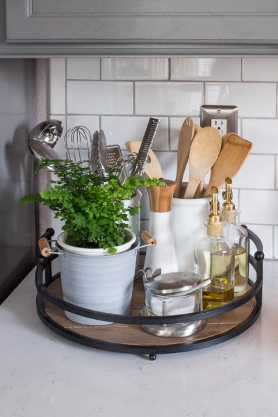 Use a turnstile and decorative pieces to store and organize your kitchen utensils and other items on your counter top.