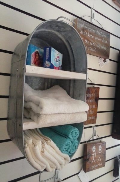 Turn an old wash tub into a shelving unit for your wall. Really love this idea!