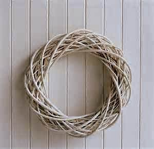 This willow wreath will perfectly compliment farmhouse or shabby chic decor.