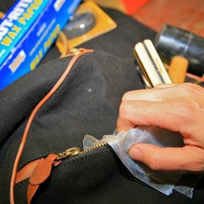 Rub wax paper on a zipper to help get it unstuck.
