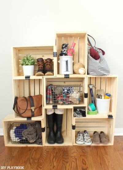 Use crates and binder clips to create storage in a small apartment.