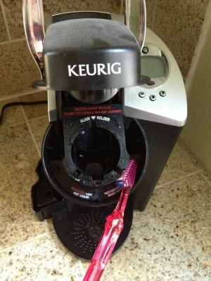 Use a simple toothbrush to clean the nooks and crannies of your Keurig. Genius idea!
