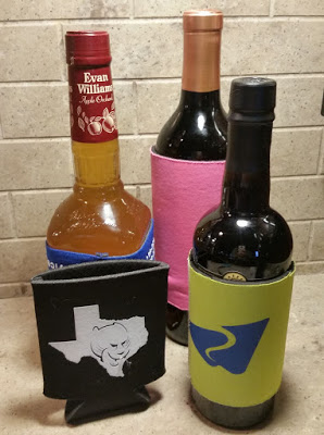 Cut the bottom off a koozie and use to protect your wine bottles from clanging against each other or breaking when traveling.