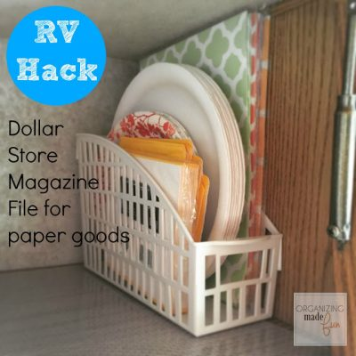 Use this dollar store container to organize paper goods in your kitchen cabinets.