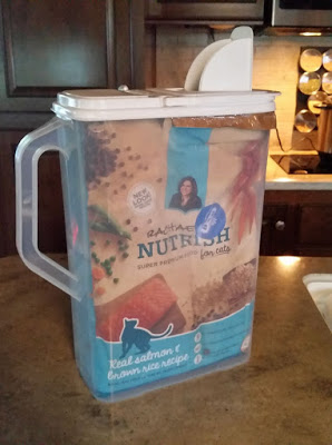 Store pet food in a pour out container while traveling.