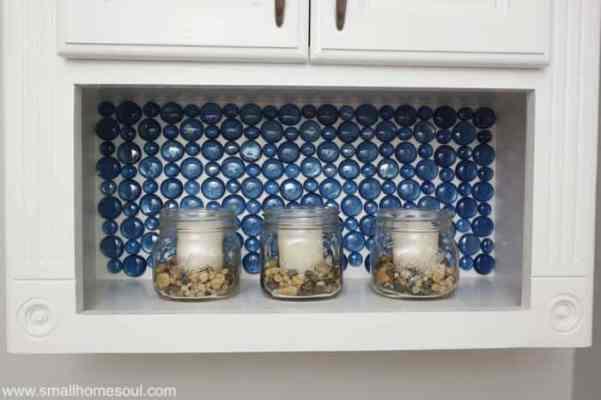 Make a backsplash using pebbles from dollar store.