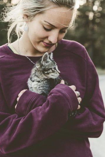 woman holding kitten