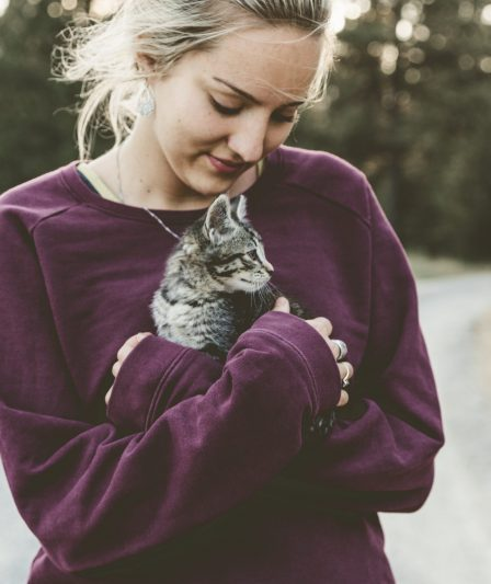woman holding kitten