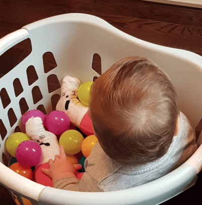 Bring a ball pit into your home for a fraction of the price. Simply fill a laundry basket with plastic balls and let the little ones go to town! | Toddler Parenting Hacks