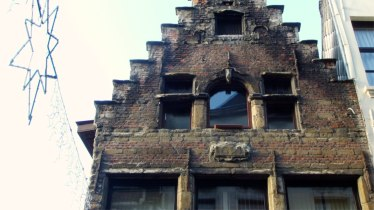 Many old brick buildings in Antwerp have survived time and the wars. But they do not shine like in the glory days of this port city.