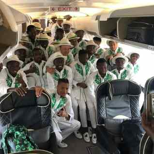 Super-Eagles-with-Coach-Gernot-Rohr-displaying-their-uniform-in-Russia-bound-aircraft