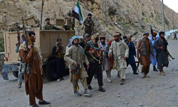 Afghan resistance movement and anti-Taliban uprising forces patrol a road in Rah-e Tang, Panjshir province Photo: AHMAD SAHEL ARMAN / AFP