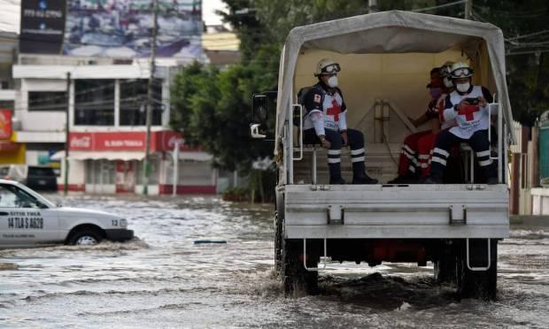 Red Cross members patrol flooded streets after heavy rains fell on Tula de Allende, Hidalgo state, Mexico Photo: ALFREDO ESTRELLA / AFP