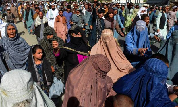 People participate in march to protest Taliban announcement in Kandahar, Afghanistan Photo: JAVED TANVEER / AFP