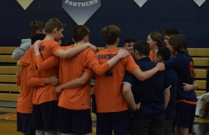 Panther Volleyball players in a huddle