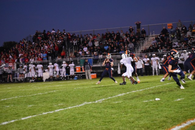 Quarterback drops back in pocket and looks to throw towards the endzone.