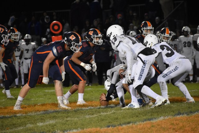 Panthers defense lines up on the line of scrimmage to defend an Oswego East punt.