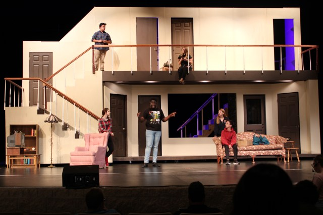 Actors practicing the fall play in a dress rehearsal.