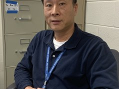 Mr. Tu in his classroom.